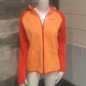 Nike hooded jacket with pockets and thumb holes.